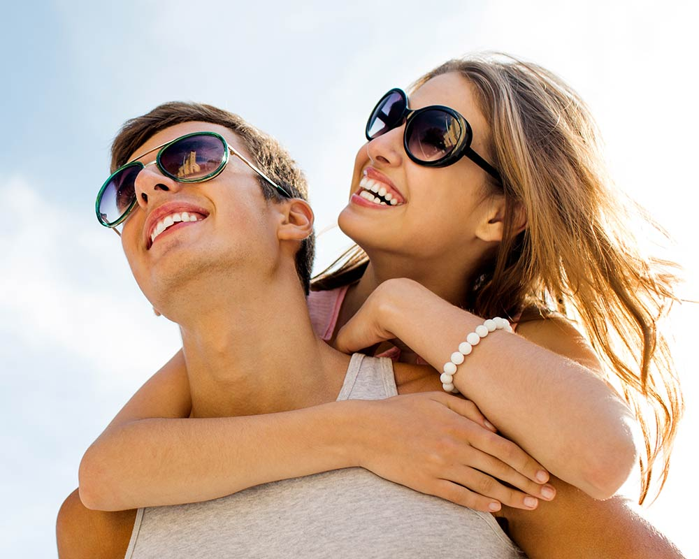 Young couple smiling with sunglasses on